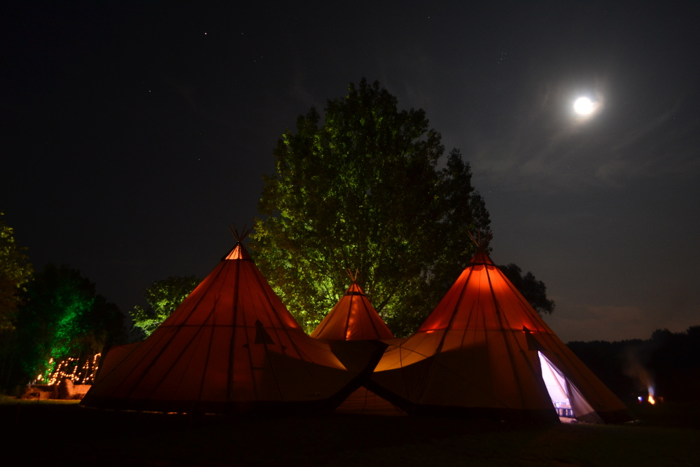 The tipis at chalkney water meadows 3 x giant tipis with a maximum capacity to seat approx. 200 guests. This includes:tables & benches ,wood floor, lighting,dance floor/ speakers/ disco lights & bar unit