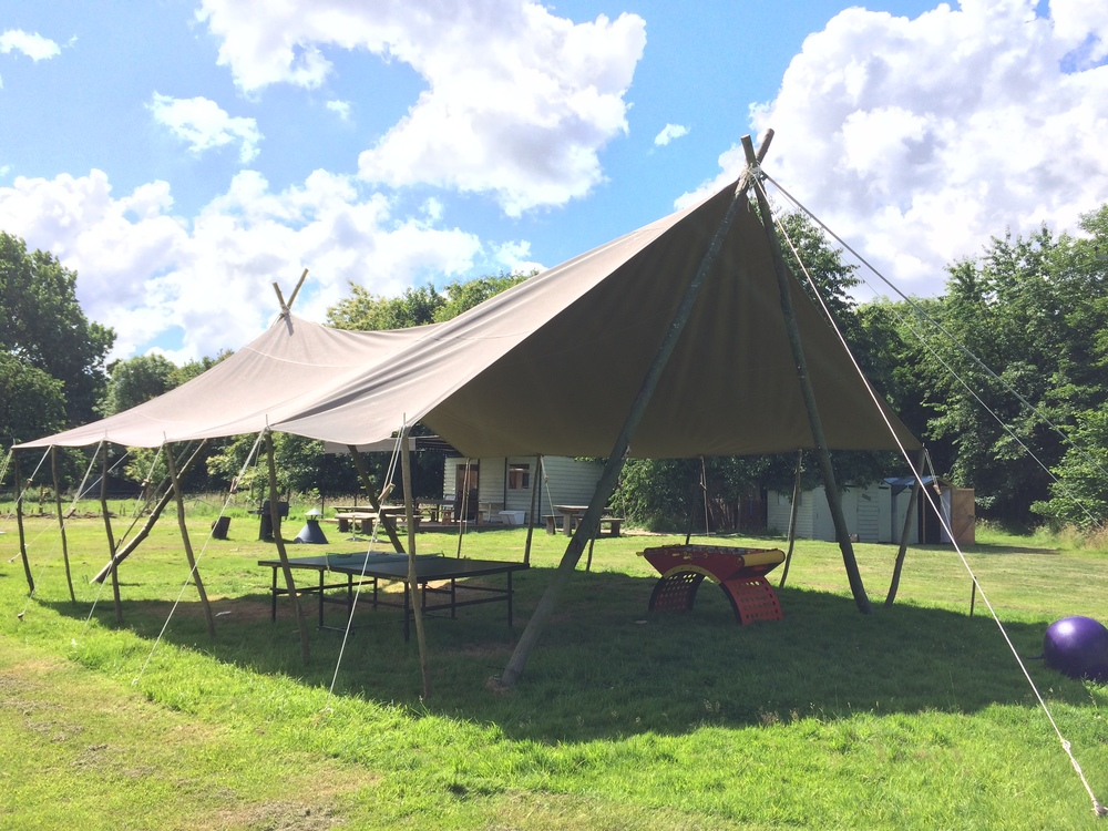 30 x 30 ft awning AT TEY BROOK ORCHARD OUR UNDERCOVER AWNING PROVIDES A GREAT SPACE TO BE USED AS A CHILL OUT AREA AND GAMES ROOM. ALTERNATIVELY IT CAN BE USED AS A DRINKS RECEPTION OR AN AREA TO EAT UNDER.