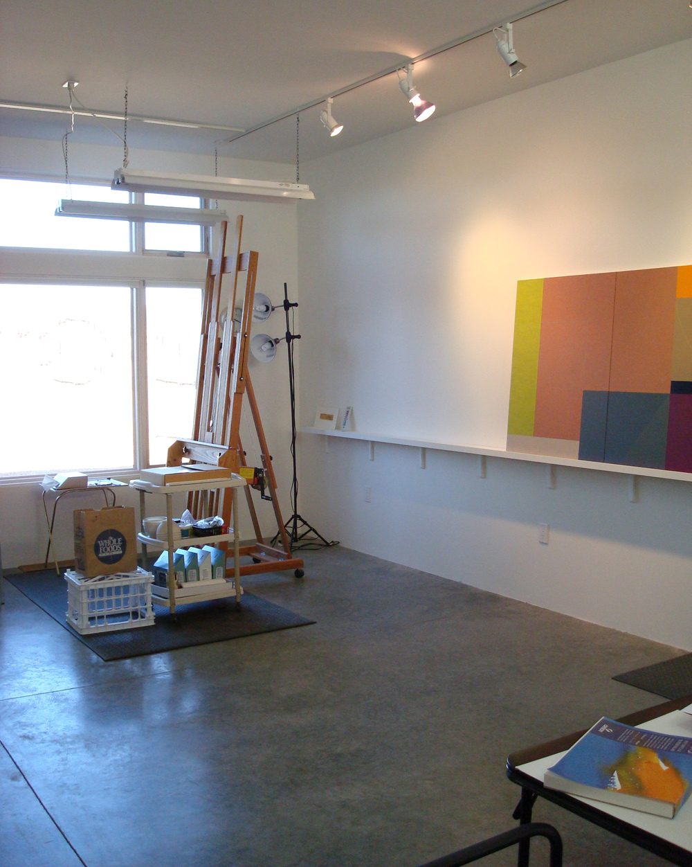 Danielle Shelley's easel with north window, plus painting shelf and work table, in new studio.