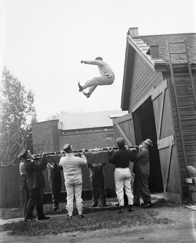 Learning to jump into a safety net.  Fire Department Training Academy, Rochester, NY, 1912.