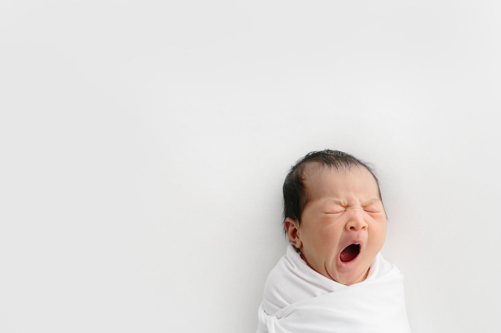 Baby yawning during newborn photography session in Melbourne