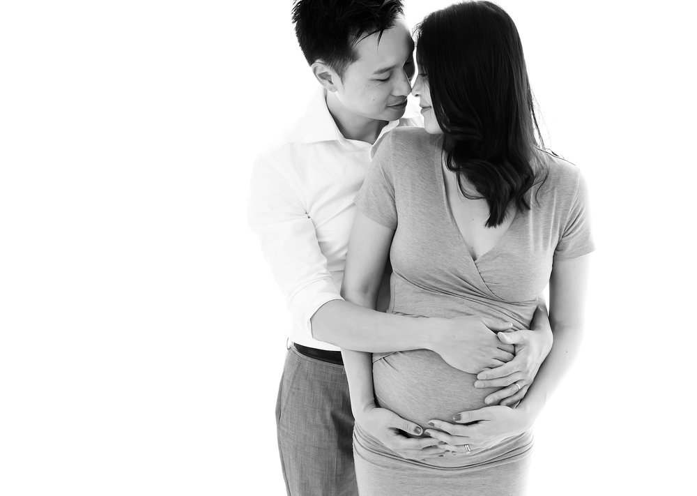 A natural photo of a new mum and dad during their maternity photo shoot in Melbourne