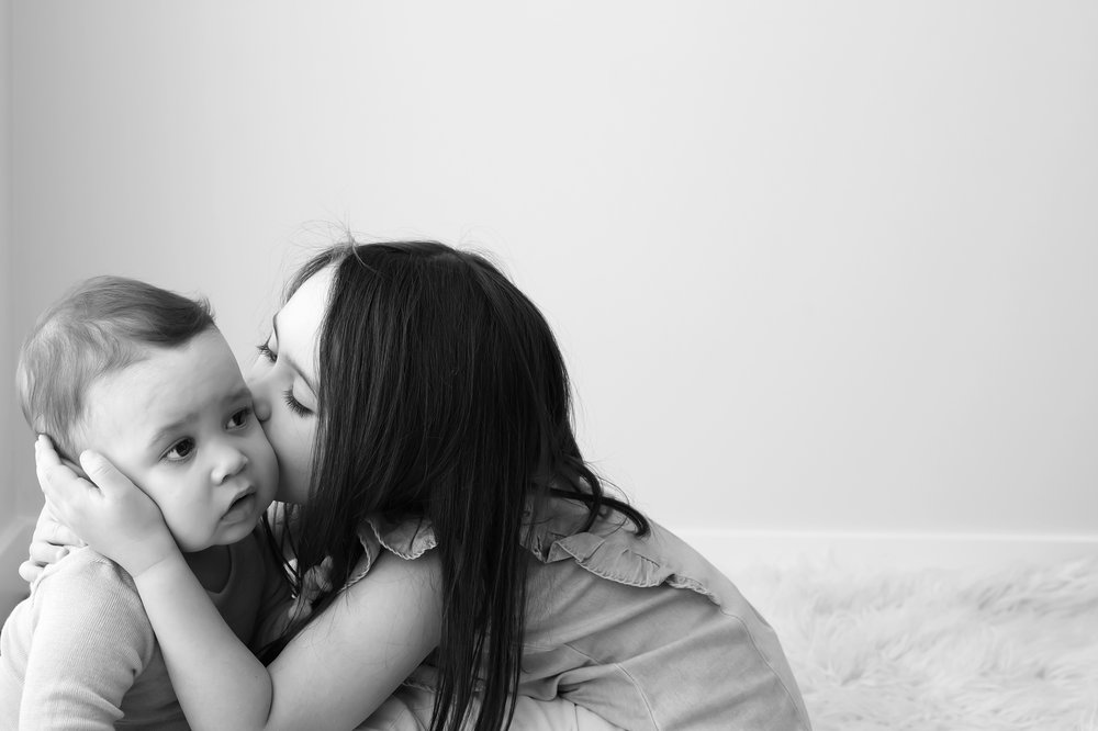 Black and white photo of brother and sister taken by professional family photographer in Melbourne