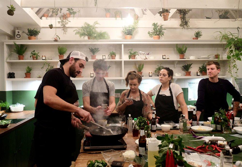 Paul teaching how to cook the KraPow