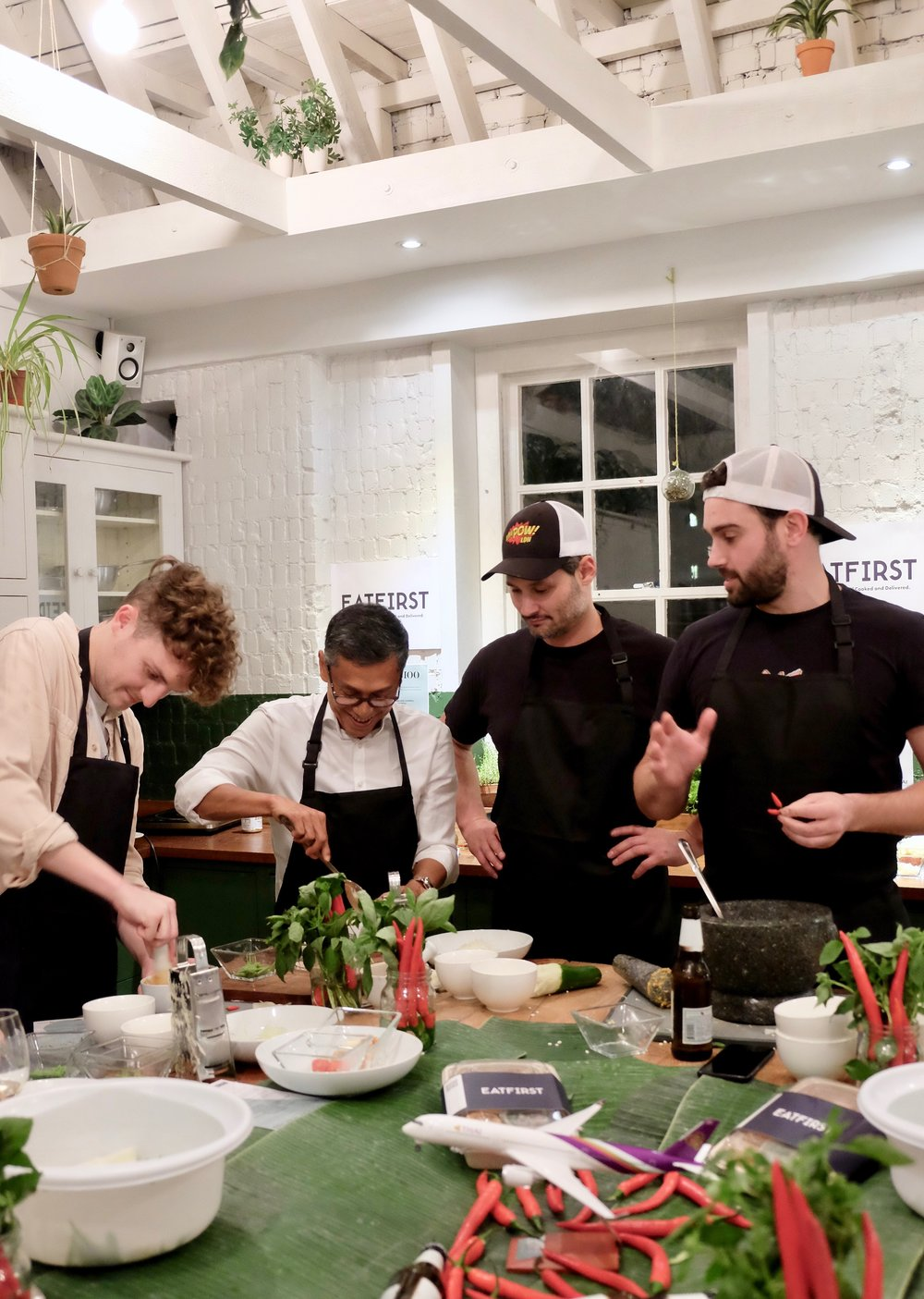 Rich & Paul teaching how to make the Som Tam Salad