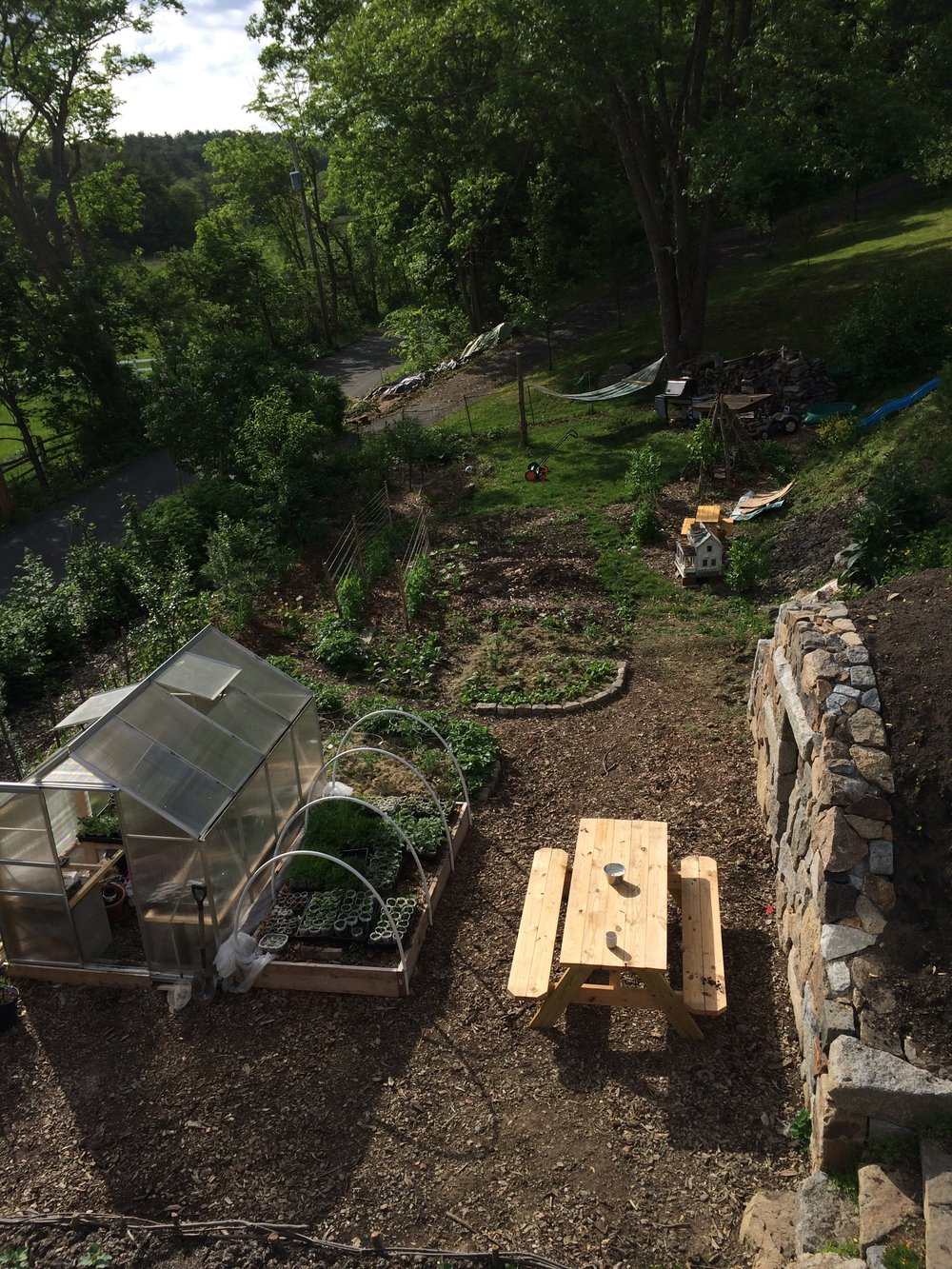 May 2018  A few weeks later, the gardens are just coming in, the root cellar is so close to being done…
