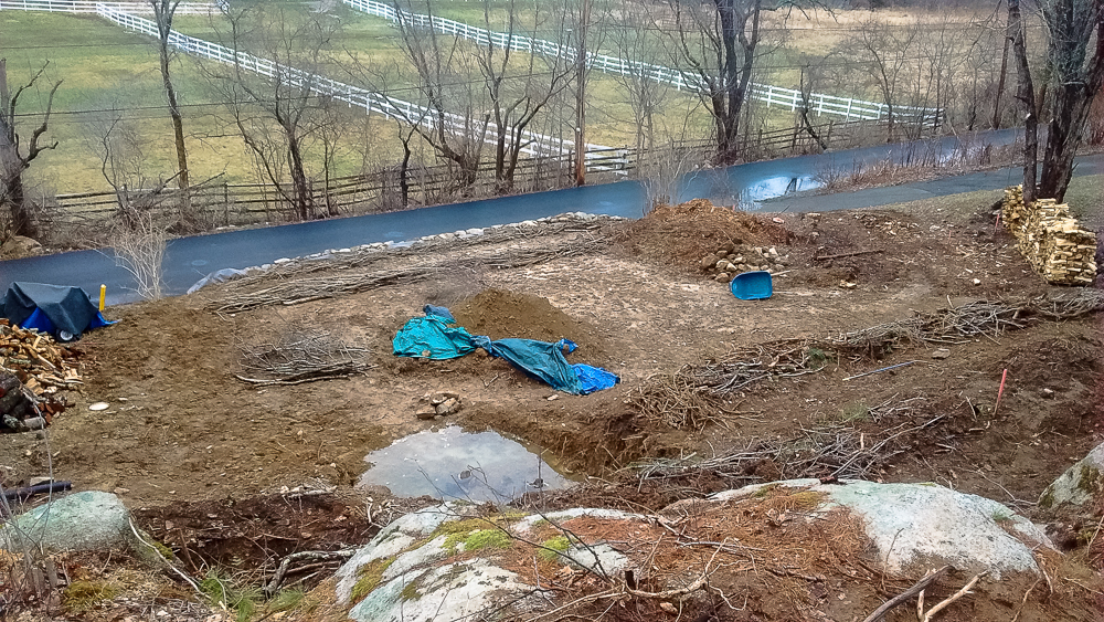 March 2016  Putting in the hugelkutlur beds on bottom 2 of 4 levels of terraces and along stone wall.