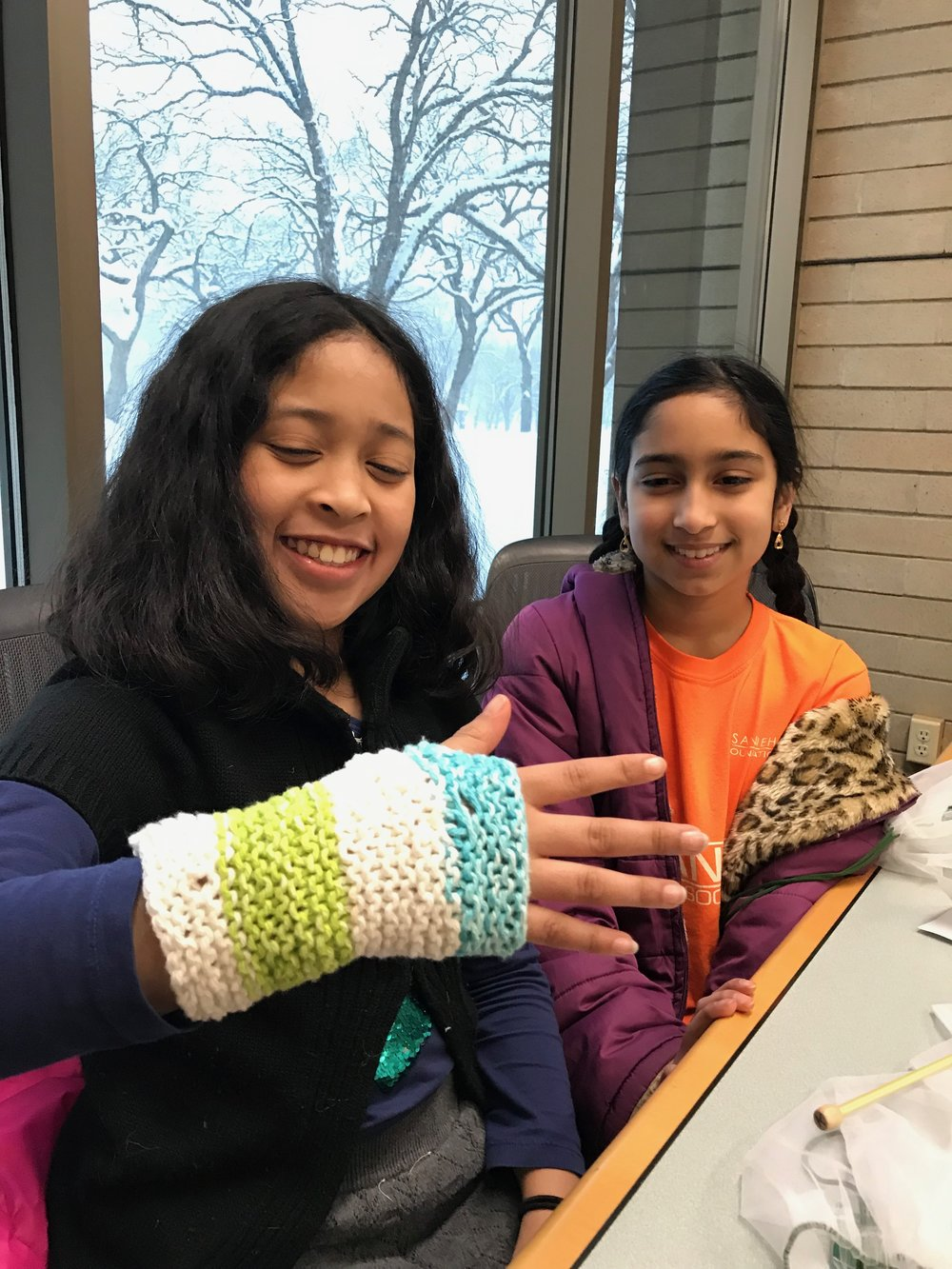 Tatum's finished fingerless glove. Now she will learn how to Purl and will start the other one. Good job, Tatum!
