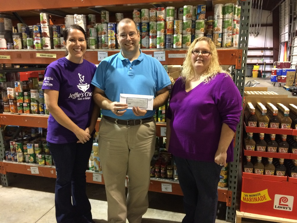 From left to right: Elizabeth Rohme, Audit Manager at Mariner Finance and one of the Jeffie's Choice founders, Chad, Director of the Milford, DE Food Bank branch, and Monica Rash, Branch Manager of the Seaford, DE Mariner Finance branch.