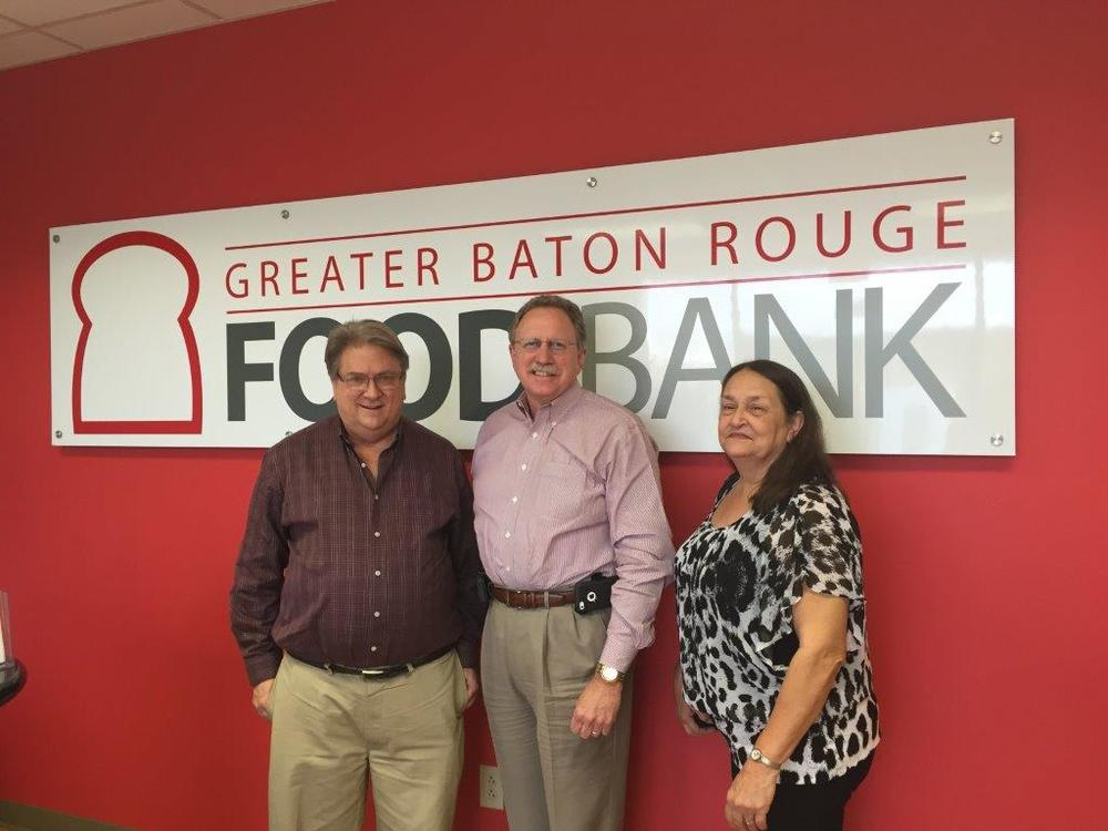 Left to right: Stephen Richard, Branch Manager of the Pioneer Credit Company Baton Rouge, LA branch, Mike Manning the President and CEO of the Baton Rouge Foodbank, and Rita McMillian, Customer Service Representative in the Pioneer Credit Company Baton Rouge, LA branch.