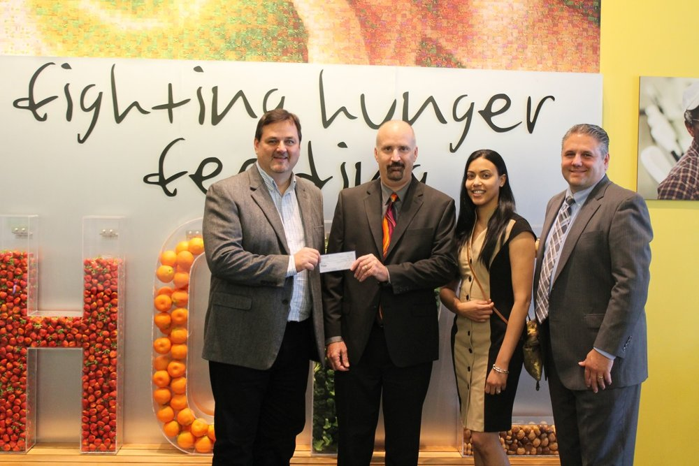 On January 2, 2018, Greg Higgerson, on behalf of the  Second Harvest Food Bank of Central FL , accepted a $4,000 donation delivered by Mariner Finance's Michael Hiti, Tatiana Pacheco and Sal Scaffidi to help with the immediate needs from Hurricane Irma.