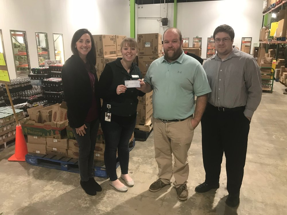 On December 28th, 2017, Jeff Zuch and Eric Todd of Mariner Finance visited the  Food Bank of Central and Eastern NC   to deliver a $1,500 donation to staff at the Food Bank.