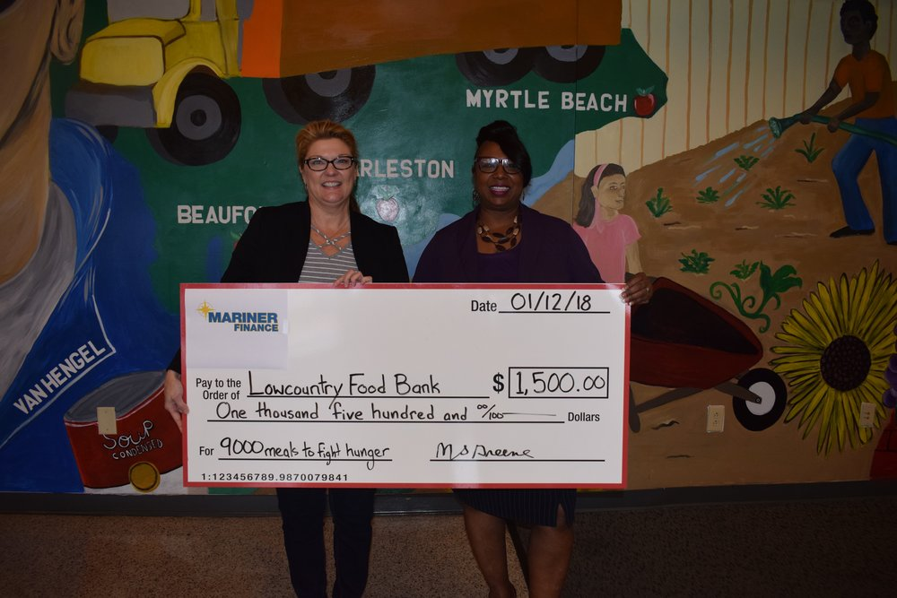 Pictured from left to right: Kathryn Douglas - Chief Advancement Officer of Lowcountry Food Bank; Melvenia Greene– Branch Manager of Mariner Finance in Charleston, South Carolina
