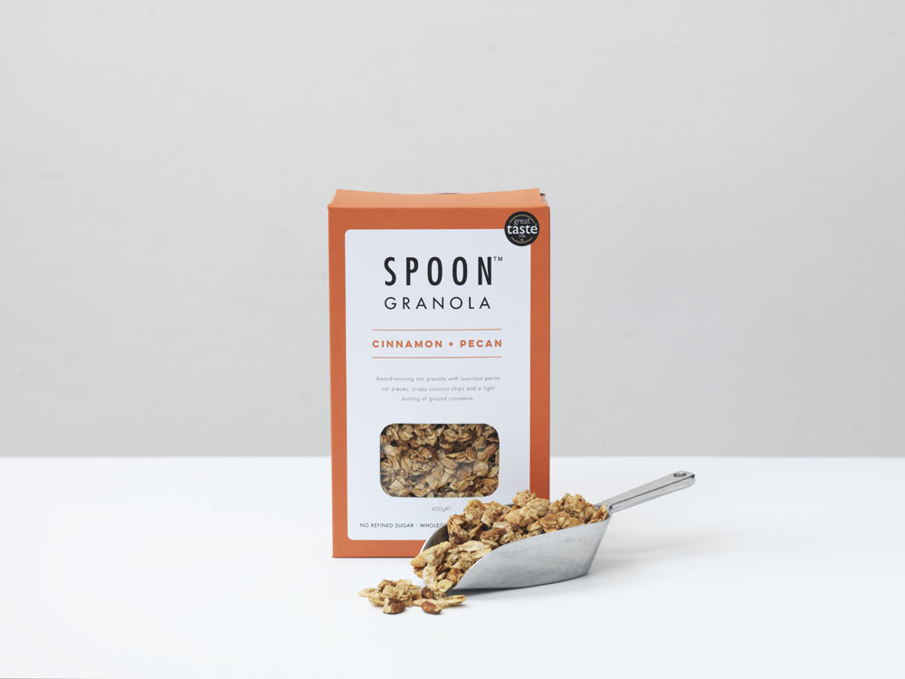 GRANOLA: CINNAMON + PECAN - Wholegrain Oats (47%), Coconut Chips (15%), Honey, Pecan Pieces(8%), Rapeseed Oil, Maple Syrup (4%), Natural Vanilla Flavouring,Ground Cinnamon (0.3%), Sea Salt (Allergens in bold)Nutrition / 45g serving:Energy 951KJ / 228KCAL, Fat 12.1g, of which saturates 3.9g, Carbohydrate 23.9g, of which sugars 5.6g, Fibre 3.2g, Protein 4.2g, Salt 0.03g