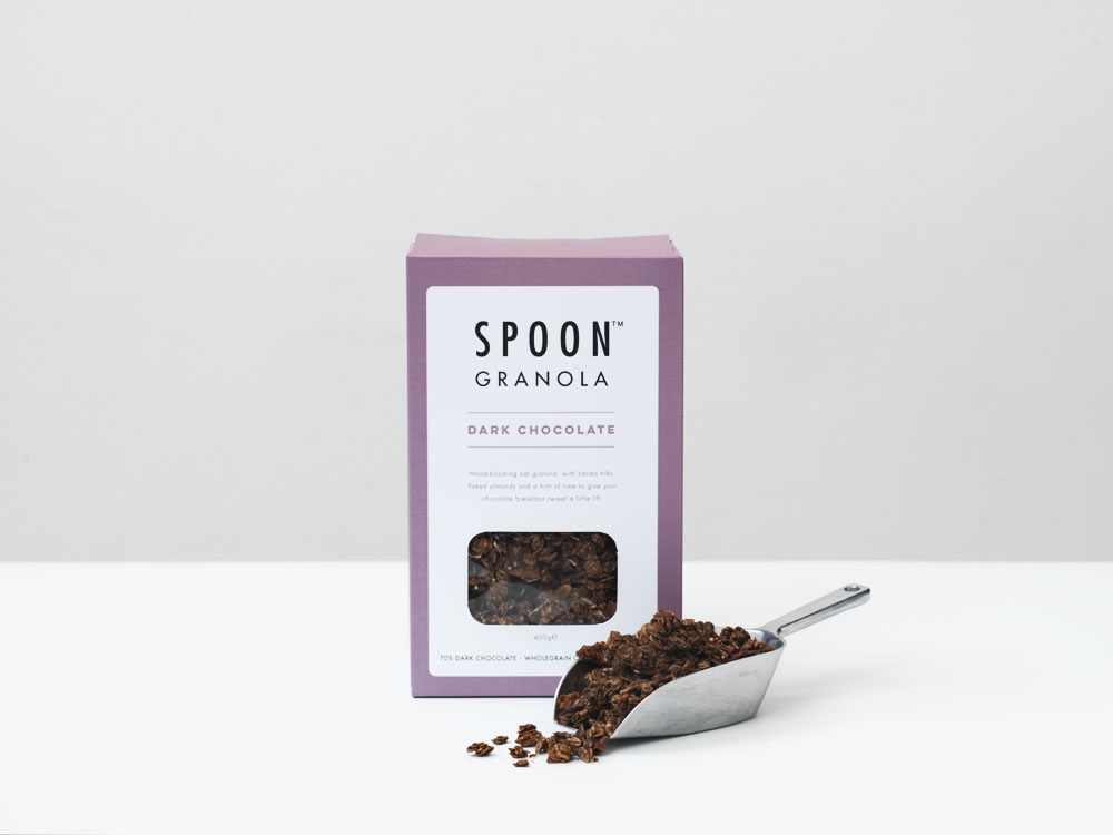GRANOLA: DARK CHOCOLATE - Wholegrain Oats (57%), Rapeseed oil, Honey, Coconut Chips (9%), Dark Chocolate (6%) - cocoa mass, sugar, fat reduced cocoa powder, emulsifier, soya lecithin, natural vanilla flavouring,  Flaked almonds (4%) Maple Syrup (3%), Cocoa powder, cacao nibs (1%), Lime extract (0.01%) (Allergens in bold)Nutrition / 45g serving: Energy 880KJ / 210KCAL, Fat 9.7g, of which saturates 3.1g, Carbohydrate 24.5g, of which sugars 4.6g, Fibre 3.9g, Protein 4.4g, Salt 0.01g