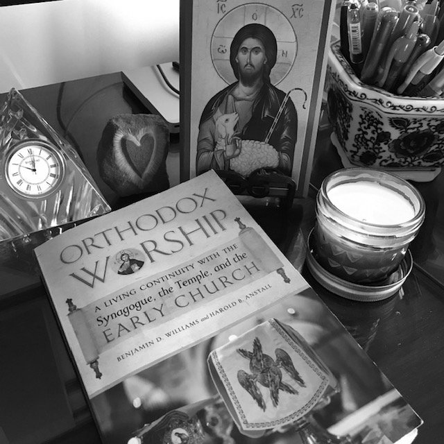 A photo of ORTHODOX WORSHIP next to the icon of Christ