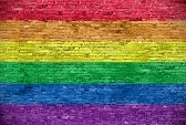 33817077-rainbow-flag-over-old-brick-wall.jpg