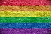 33817077-rainbow-flag-over-old-brick-wall.jpg