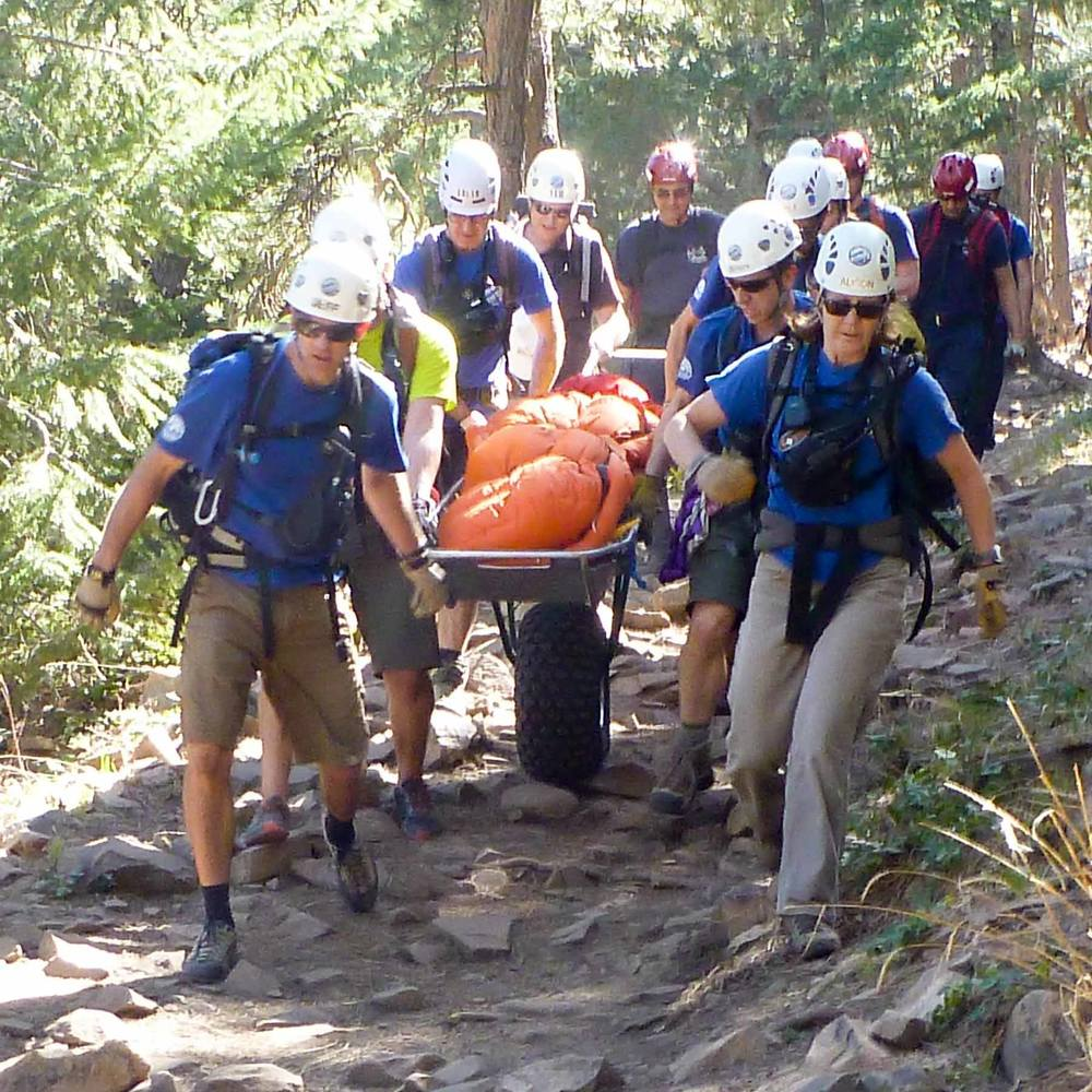 Rocky Mountain Rescue Group members conduct a wheeled litter evacuation on Boulder's 2nd Flatiron, lower trail.