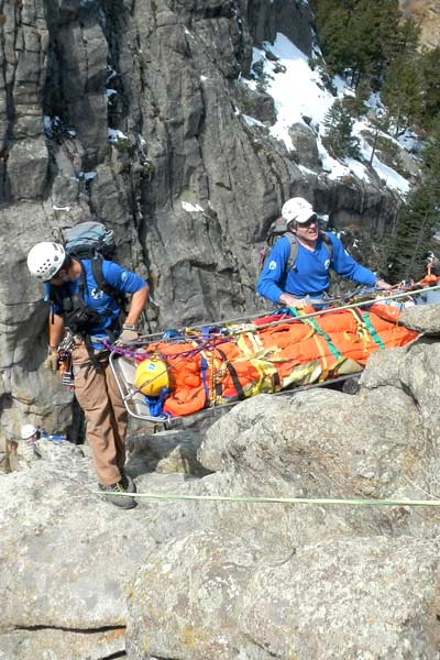 5 May-2013 Vertical/ high angle rope evacuation scenario: Litter attendant rescuers beginning to lower down Broken Rock to a (simulated) injured climber on a ledge out of site below. Photo Alpine Rescue Team, reproduced with permission.