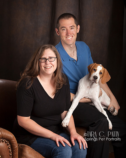 Couple with their 3 month old English Pointer