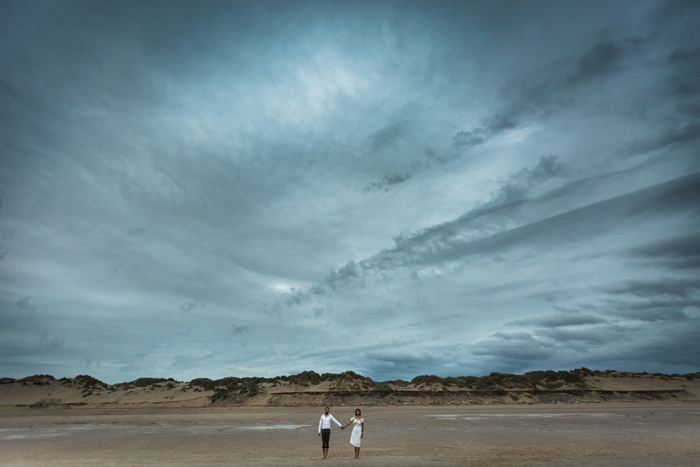 Blessed with dramatic skies on the beach for Nieran and Dina's engagement shoot
