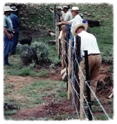 Mending a fence through a draw