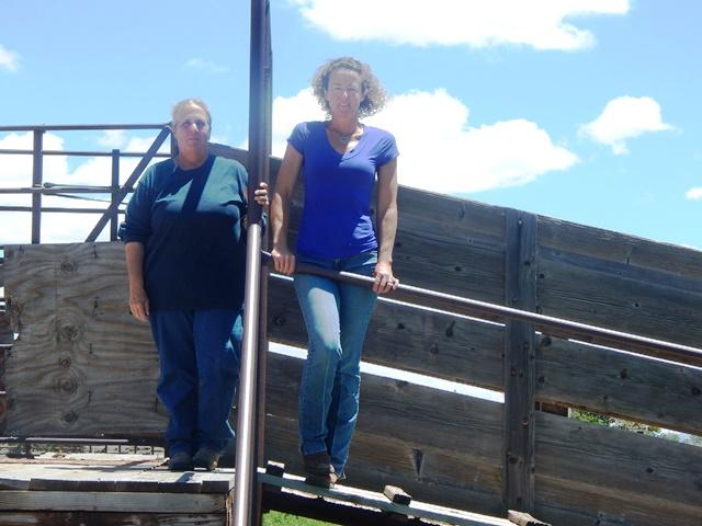 Kit Metzger (left) and Ellen Parish (right) at the stock pens at Flying M Ranch. Credit Melissa Sevigny