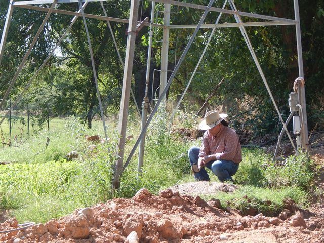 Ernesto Castro checks the well that pumps water for the ranch.