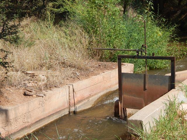 The irrigation ditch that brings water from Oak Creek at Tres Hermanas Ranch. Credit Melissa Sevigny
