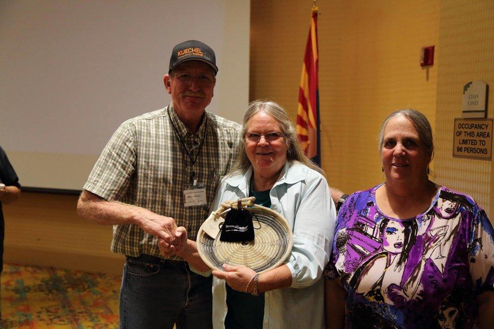 Mark Kuechel (Arizona Association of Conservation Districts Executive Board Member and Yuma NRCD supervisor) presenting the award to Diana Kessler (center) and Kit Metzger.