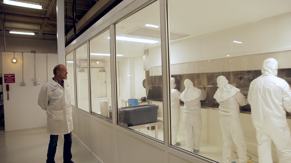 Dr. John Holiday, Aloha Medicinals inspecting clean room