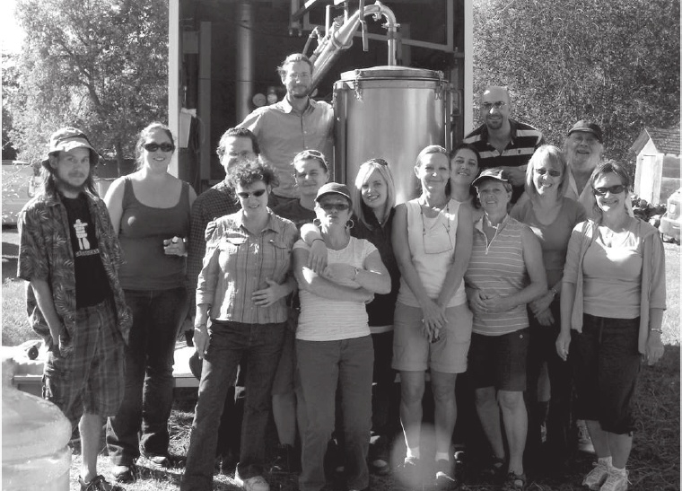 The author's aromatherapy students of Northern Star College in Edmonton gather around a portable distillation unit used to steam-distill plant species native to the Canadian province of Alberta.  Photo     by     Robert     Rogers.