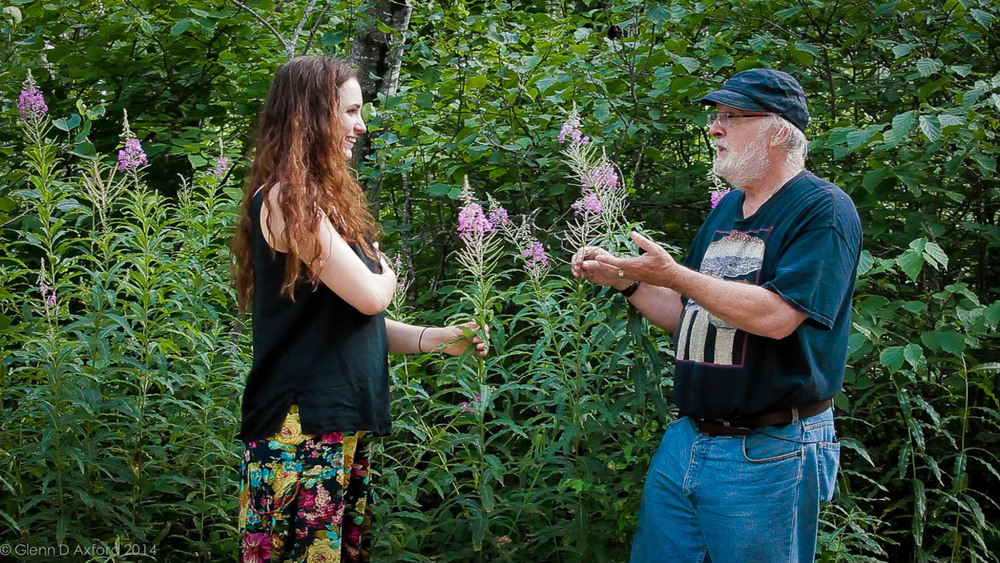 Author, Robert Rogers with young herbalist, Danielle Caners discussing Fireweed for upcoming film by Our Common Roots