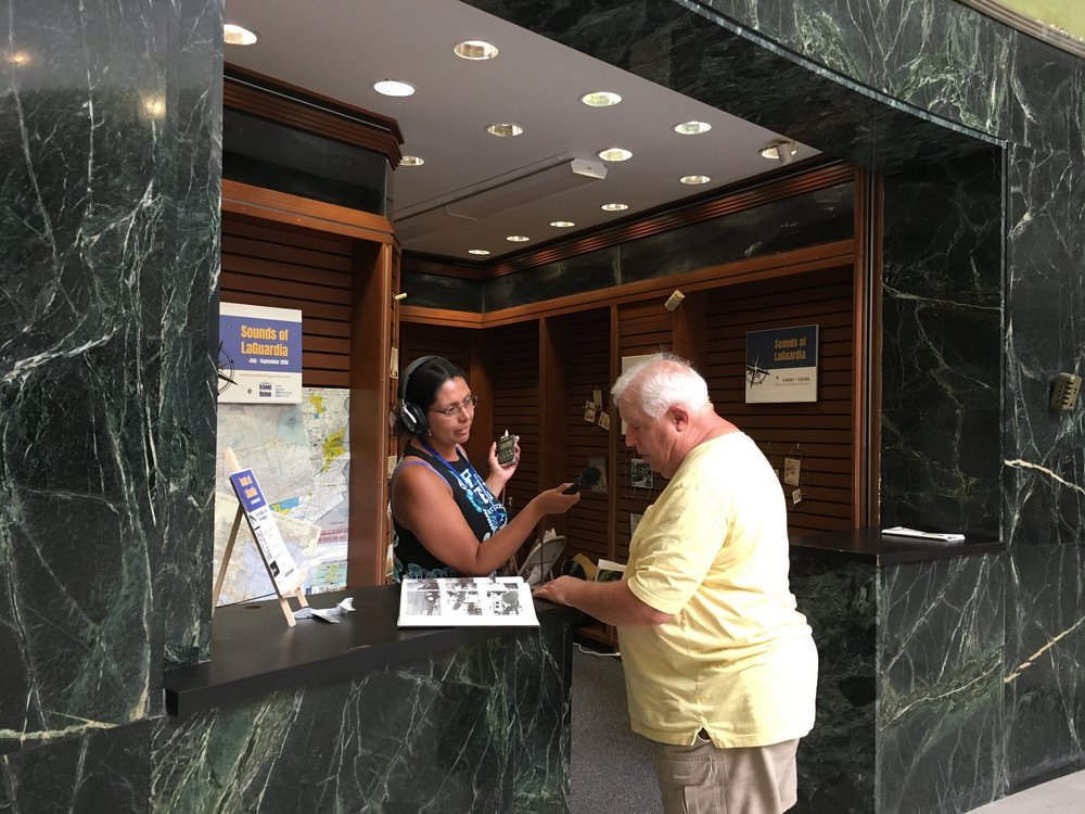 "ArtPort Artist Sandra Lopez-Monsalve interviews an airport visitor for her project ""Sounds of LaGuardia"""