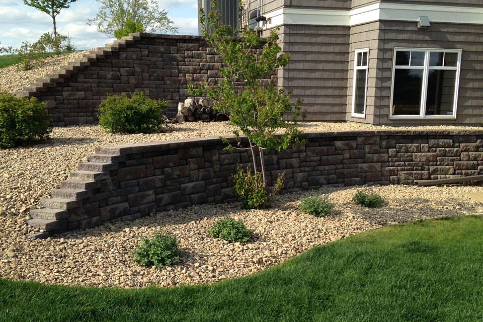 Retaining Walls with Bryant Red Landscaping Rock and Shrubs