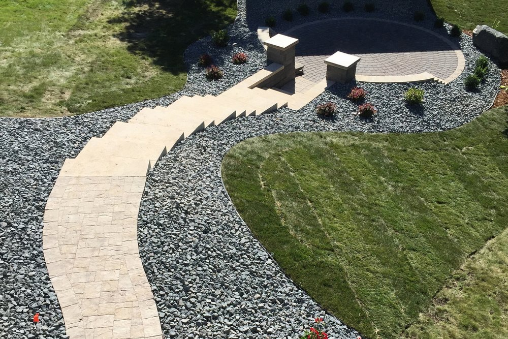 Grand Outdoor Stairway to Elegant Paver Patio