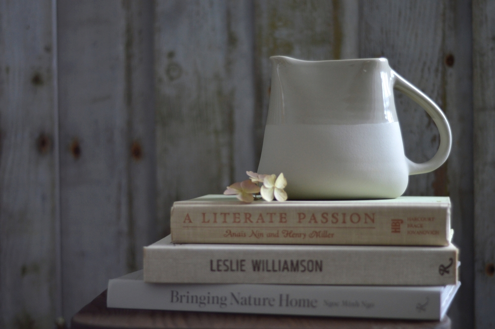 Take beautiful, taupe-y ceramic vessel