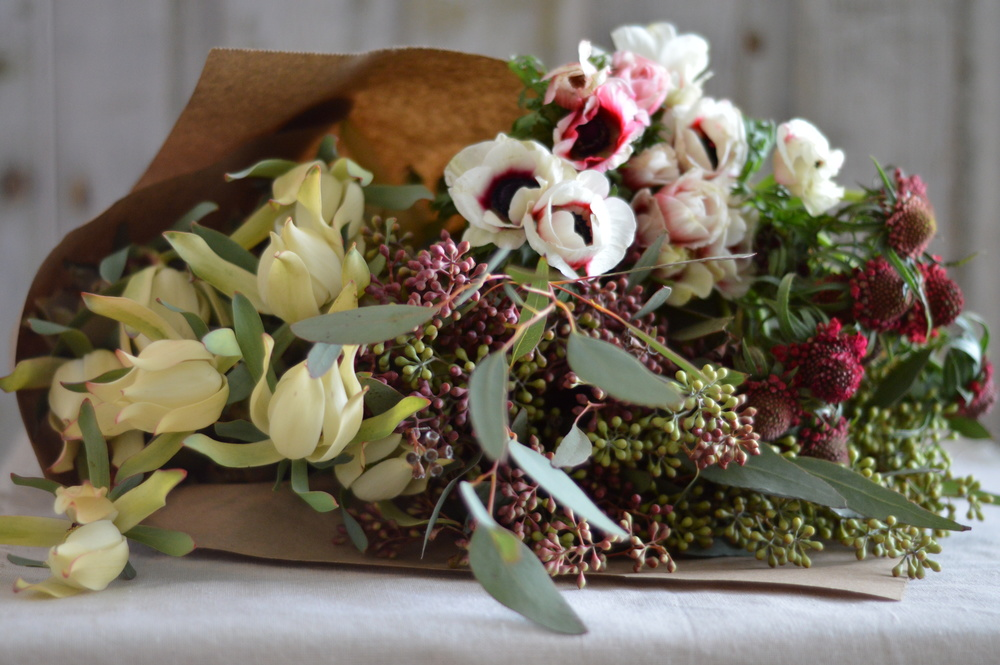 From left to right: leucadendron, seeded eucalyptus, anemone, scabiosa
