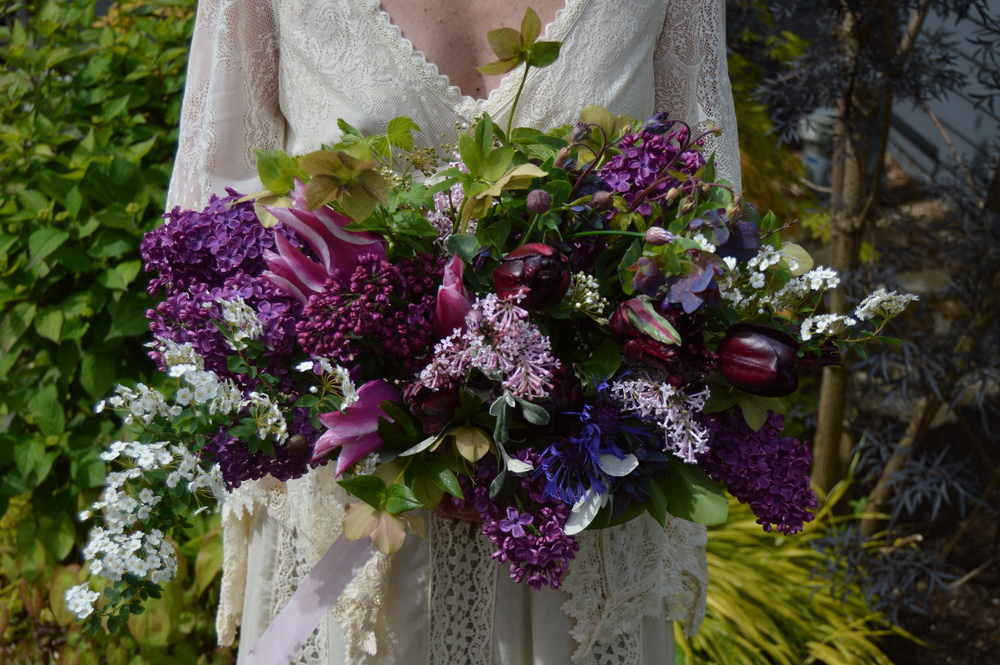 This garden-style bridal bouquet was made entirely from the cutting garden. The lavender lilac was snipped from my neighbor's yard (with permission, of course).