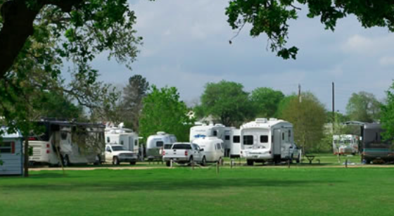 DIXIELAND TEXAS RETREAT RV PARK & RV REPAIR |  PHIL & PAULA WATKINS - OWNER CCC Member - 2017 Clean, quiet rural setting. Full service, 30 & 50 amp, seventy foot pull-thru sites. Certified experienced RV technician on site. Restrooms, showers, laundry, dump station, pond fishing, tent camping & clubhouse for clubs and groups. Long term available. A 36' luxury 5th wheel trailer on site for rental and camping cabin with AC/heat. Propane is now available between 9:00 and 6:00 daily phone #979-278-3805. Spur 458 - 1/2 Mile South of 290. 249 Dixieland RV Park Lane | Carmine, TX 78932 979-278-3805   8 miles from Round Top Square