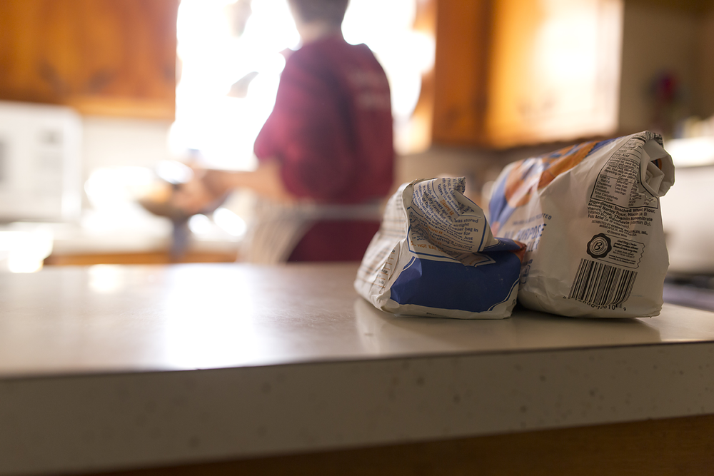 I roll my flour bags the same way, and store them in the freezer, just like my mama.