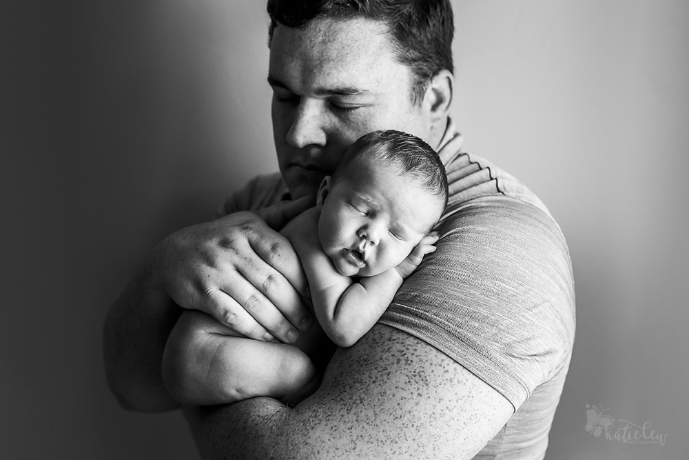 newborn boy with dad picture