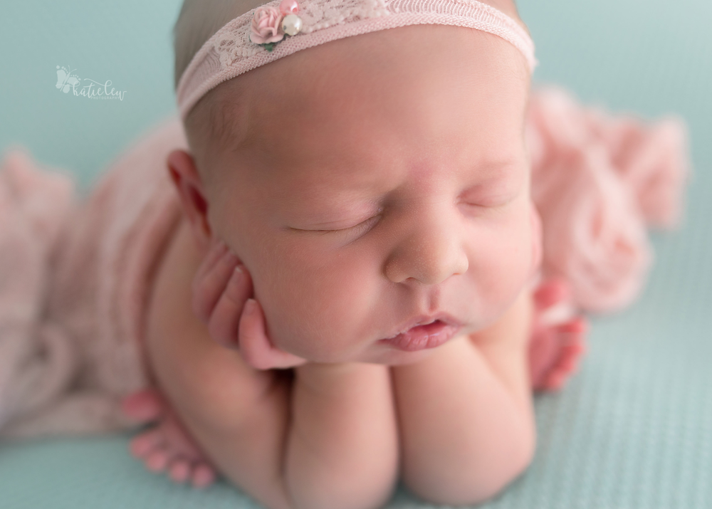 Up close picture of a tulsa born newborn girl in froggy pose.