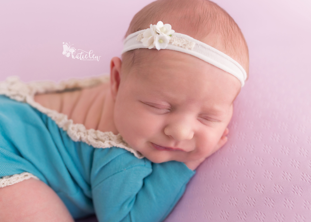 Smiling newborn girl.