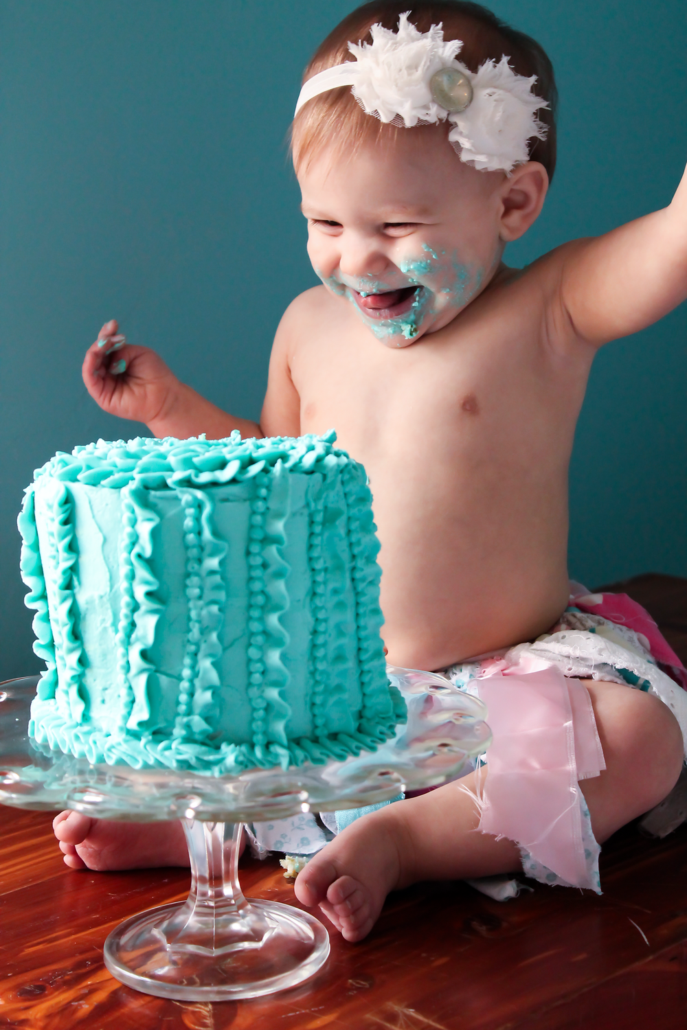happy baby girl eating her cake