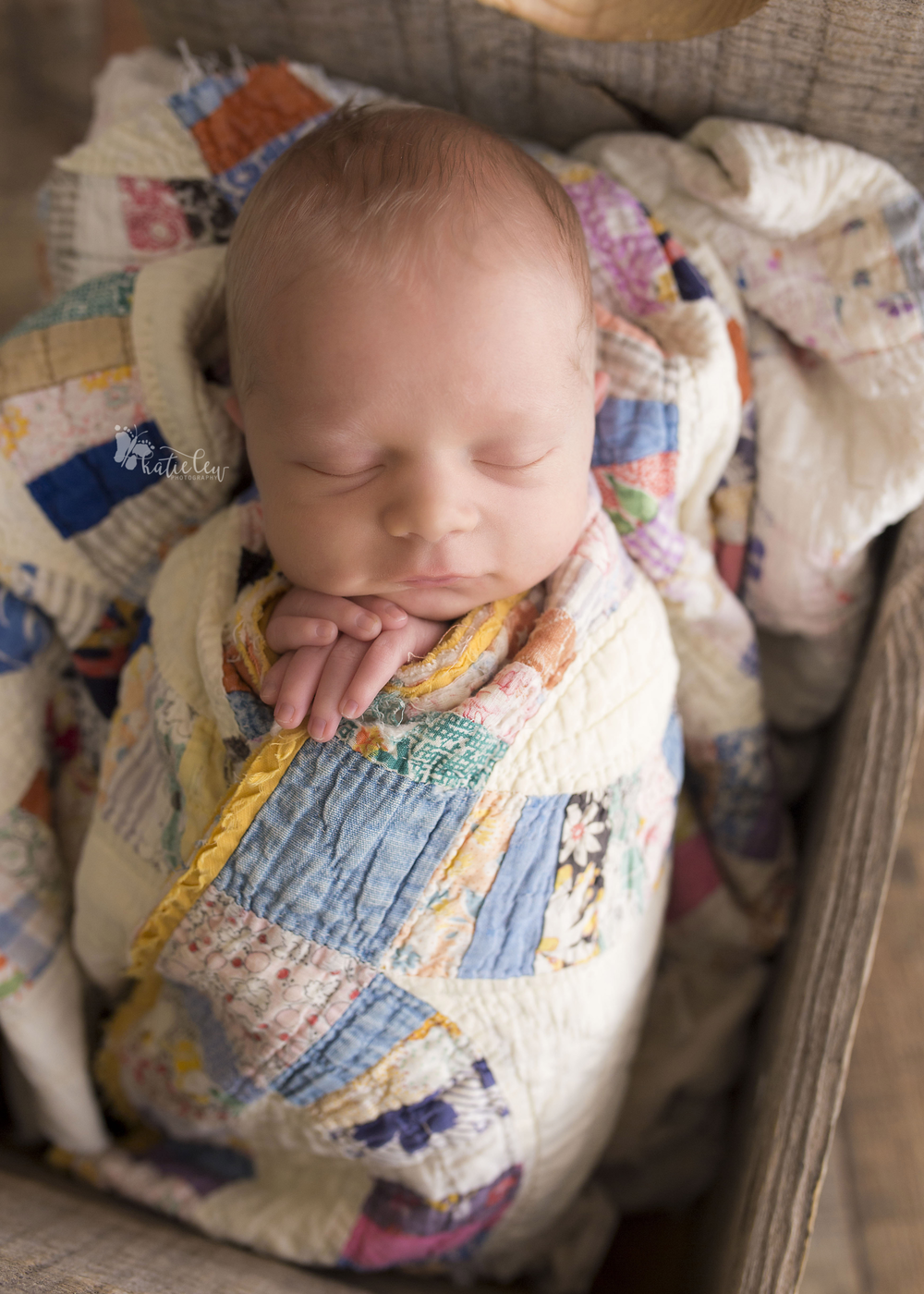 baby wrapped in quilts and tucked in bed
