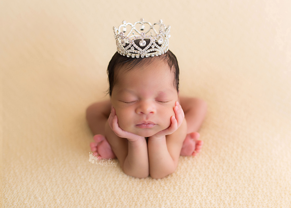 Sweet newborn girl wearing a beautiful crown