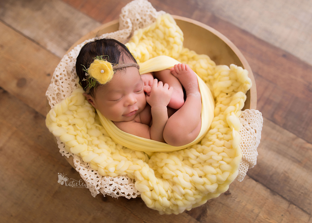 yellow blanket, wrap, and flower on a newborn girl in oklahoma