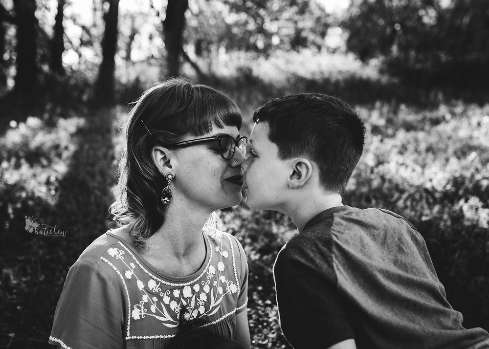 A mom and son doing eskimo kisses